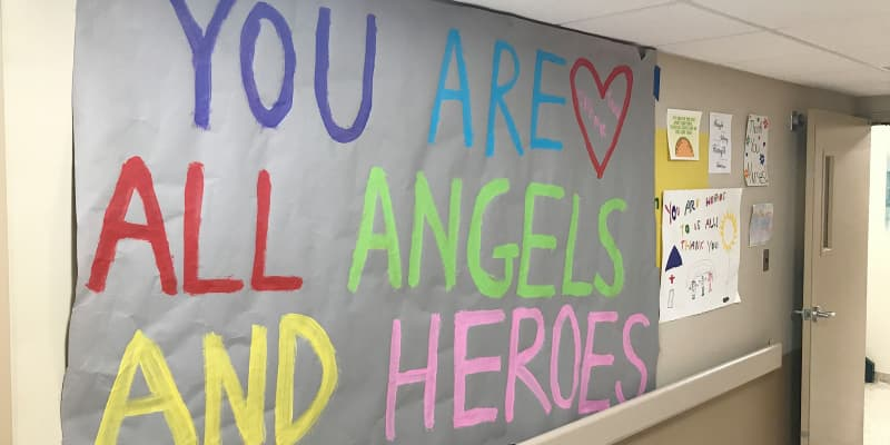 'You are all angels and heroes' sign