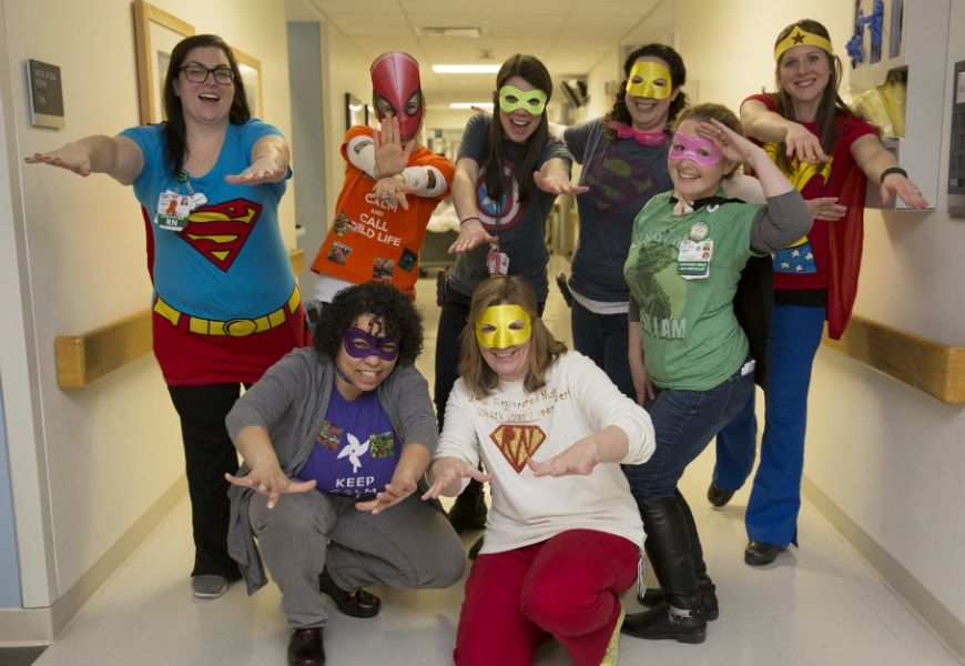 child life team dressed up as super heroes