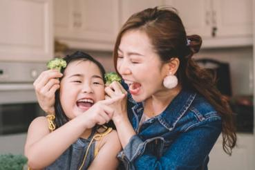 A child eating with her mom
