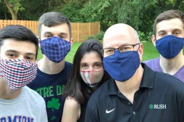 Rush Copley CEO John Diederich and family wearing masks