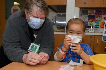 Rush University Children's Hospital patient gives a helping hand to COVID-19 vaccine clinic