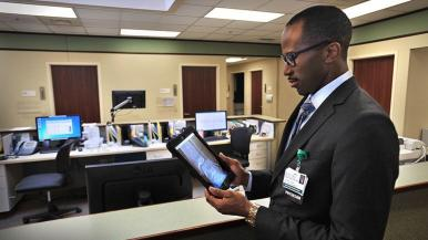 Dr. Akoh reviewing image on tablet