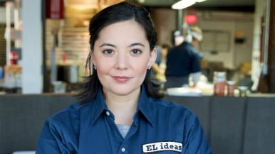 Akiko Moorman wearing a uniform shirt from EL ideas