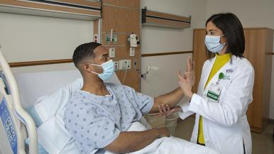 A doctor at Rush examines a patient